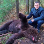 Rampaging brown bear digs up graves and gnaws corpse in one Russian cemetery, while invading predator is shot dead raiding burial plots at another