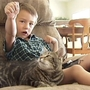 Cat attacks dog to save boy owner from mauling, Bakersfield, California, America – 13 May 2014